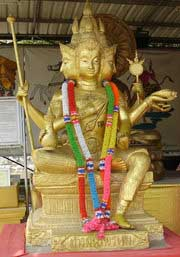 Statue of the Hindu god Brahma in a Buddhist Temple, Wat Phanan Choeng, Thailand