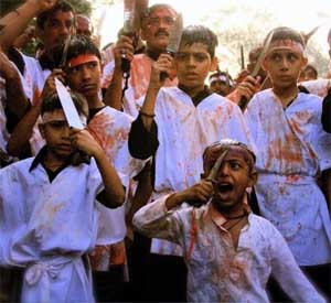 Shia Muslims in India celebrating the annual holiday of Ashura by mutilating themselves and their children in an act called