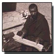 Tibetan Buddhist holding scrolls